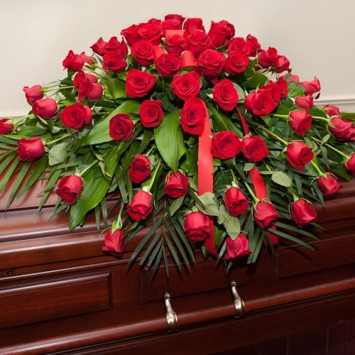 Dearly Departed Casket Spray - Red Roses